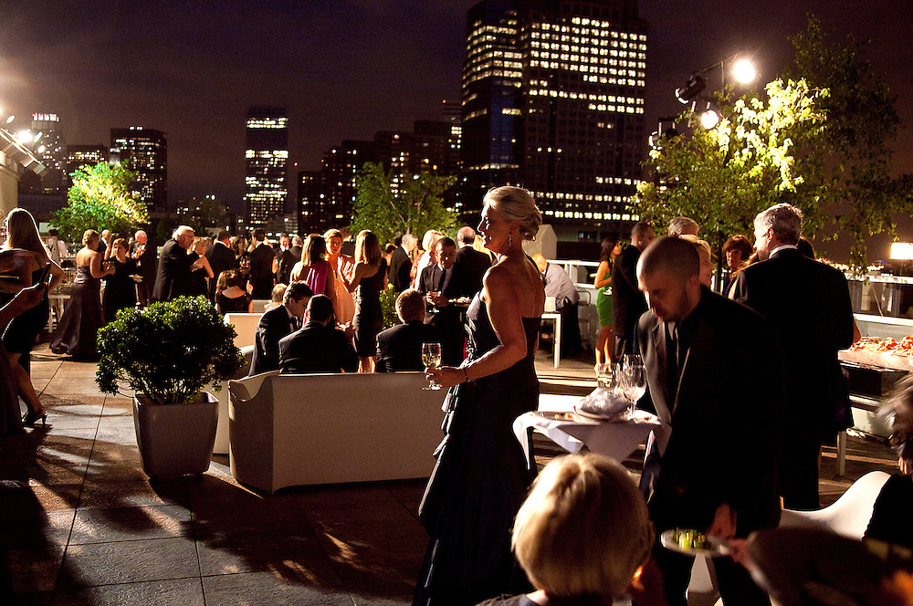Panoramic photo of wedding reception at night on a Tribeca Manhattan rooftop
