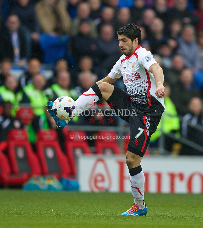 CARDIFF, WALES - Saturday, March 22, 2014: Liverpool's Luis Suarez in action against Cardiff City during the Premiership match at the Cardiff City Stadium. (Pic by David Rawcliffe/Propaganda)