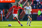 Luton Town midfielder Andrew Shinnie (11) tussles with Charlton Athletic midfielder Joe Aribo (17)  during the EFL Sky Bet League 1 match between Charlton Athletic and Luton Town at The Valley, London, England on 13 April 2019.