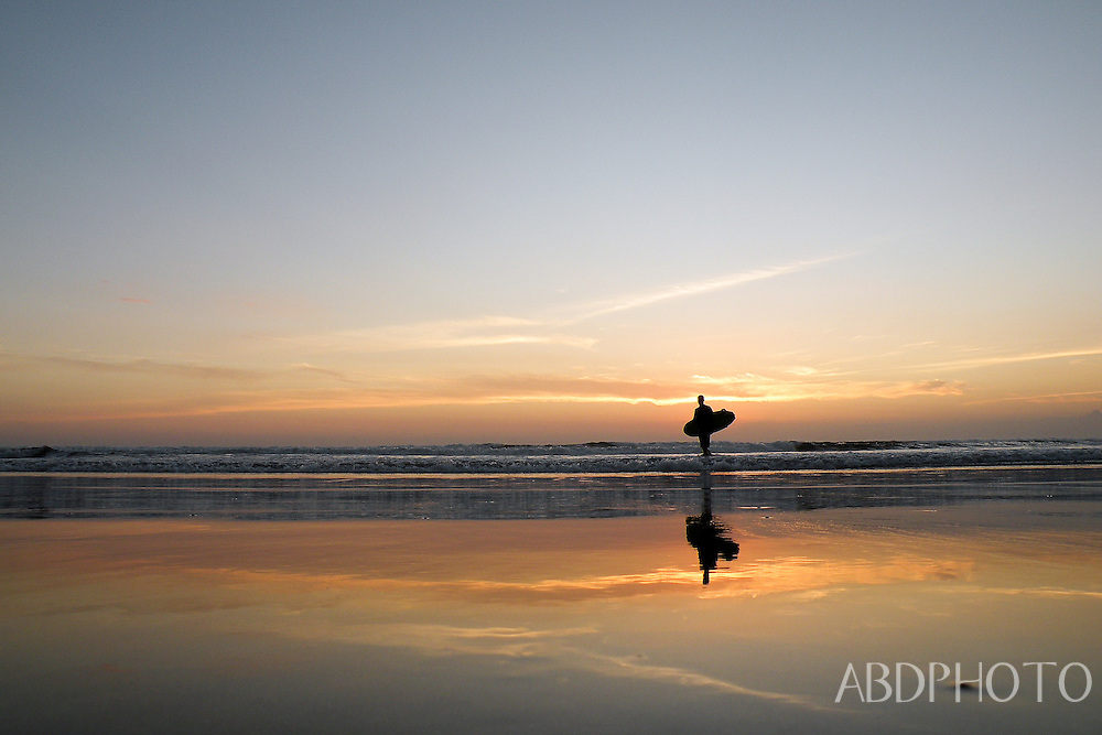 Surfers at Sunset on Kuta Beach Bali Indonesia