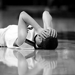 Kyle Green | The Roanoke Times<br /> 3/10/2012 Cave Spring High School boys basketball player Connor Baker (24) holds his head after sustaining a cut after hitting the floor during the game against Brunswick High School during the VHSL state basketball finals game at the Siegel Center in Richmond, Virginia on Saturday. Brunswick defeated Cave Spring 48-33