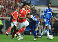 20120327: LISBON, PORTUGAL - Champions League 2011/2012 - Quarter-finals, First leg: SL Benfica vs Chelsea.<br /> In picture: Benfica's Oscar Cardozo, from Paraguay, left, fights for the ball with Chelsea's Raul Meireles, from Portugal.<br /> PHOTO: Alvaro Isidoro/CITYFILES