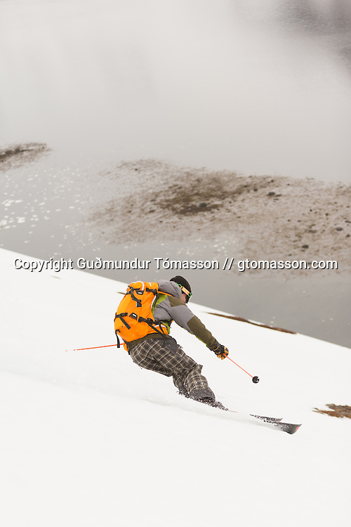 Kai Kantanen skiing in Vei&eth;ileysufj&ouml;r&eth;ur, Iceland.<br /> <br /> Images from an ski touring adventure to J&ouml;kulfir&eth;ir, a series of fjords in west Iceland, with Bergmenn Mountain Guides and Borea Adventures. The tour takes skiers from fjord to fjord with the sail boat Aurora as a overnight base.