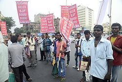 June 19, 2017 - Kolkata, West Bengal, India - All India Krishak Khet Majdoor Sangathan activists protested against police action over the protesting farmers at Mandsaur, Madhya Pradesh and burn the effigy of Prime Minister Narendra Modi. (Credit Image: © Saikat Paul/Pacific Press via ZUMA Wire)