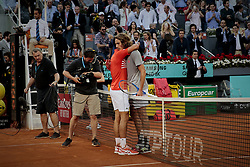 May 12, 2019 - Madrid, Madrid, Spain - Stefanos Tsitsipas from Greece and Novak Djokovic from Serbia are seen embracing after the Mutua Madrid Open Masters final match on day eight at Caja Magica in Madrid..Novak Djokovic beats Stefanos Tsitsipas. (Credit Image: © Legan P. Mace/SOPA Images via ZUMA Wire)