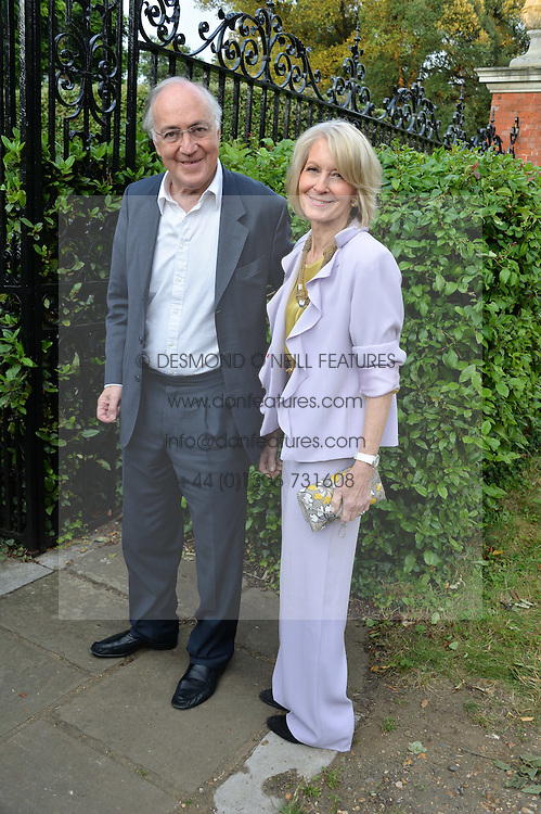 MICHAEL & SANDRA HOWARD attending Annabel Goldsmith's Summer party held at her home in Ham, Surrey on 10th July 2014.