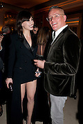 DAISY LOWE; GILES DEACON, Harper's Bazaar Women Of the Year Awards 2011. Claridges. Brook St. London. 8 November 2011. <br /> <br />  , -DO NOT ARCHIVE-© Copyright Photograph by Dafydd Jones. 248 Clapham Rd. London SW9 0PZ. Tel 0207 820 0771. www.dafjones.com.