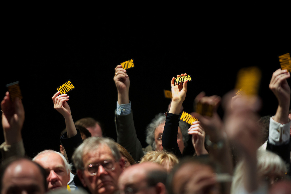 Delegates of the Liberal Democrats party raise their hands for a vote during the Liberal Democrats Autumn Conference in Liverpool on 19 September 2010.  This was the first party conference since the government coalition with the tories..