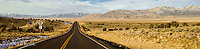 A Nevada highway crosses a valley in a straight line and then climbs into the mountains.