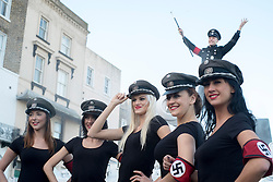 """© Licensed to London News Pictures. 27/02/2015. Margate, UK. People dressed as """"Nazi Babes"""" in front of the venue.  The UKIP spring conference at Margate Winter Gardens 27th February 2015. Photo credit : Stephen Simpson/LNP"""