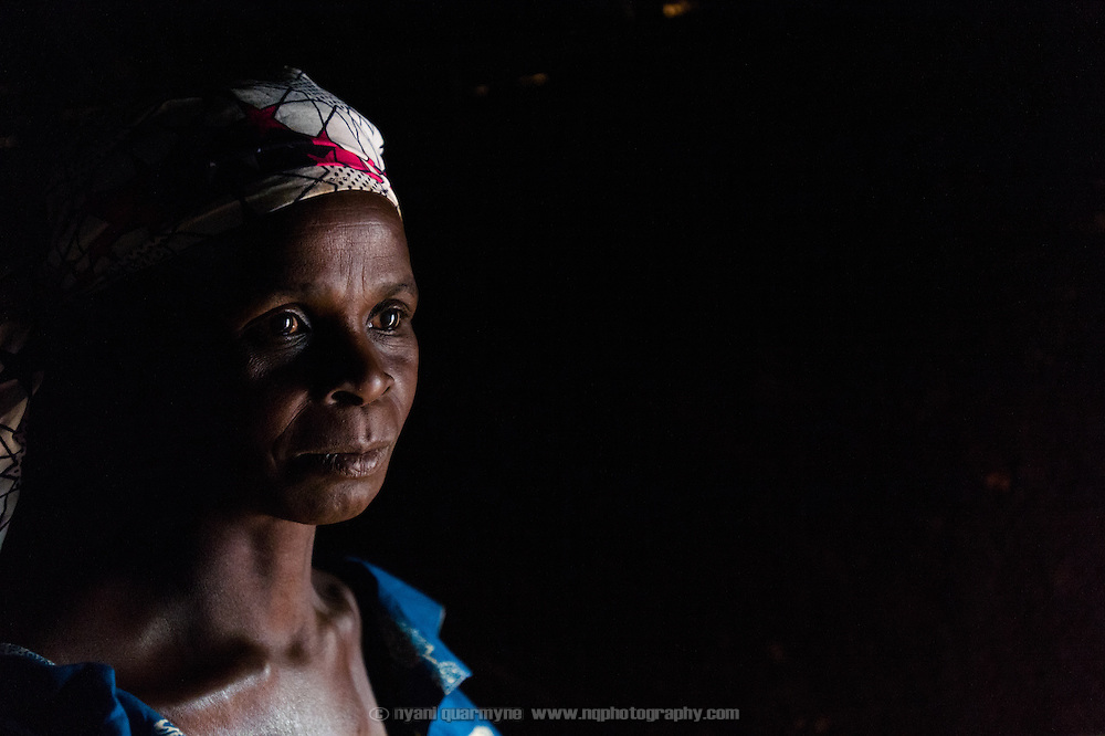 A family member in the doorway of a hut that is used a a food preparation area at a homestead belonging to the Barro extended family in the village of Toussiana in the Hauts-Bassins region of Burkina Faso, on 22 February 2016. It was also her sleeping area, but as the door is broken she has taken to sharing a relative's room.