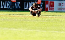 A dejected Maxime Medard breaks down as Stade Toulouse suffer another defeat.  Stade Toulousain v ASM Clermont Auvergne, Stade Ernest Wallon, Samedi 13 September 2014. Top 14 5eme Journee.
