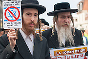 "Orthodox Jews of Neturei Karta who refuse to recognize the existence of a so-called ""State of Israel"", leading the way to the event, rue Mont-Royal."