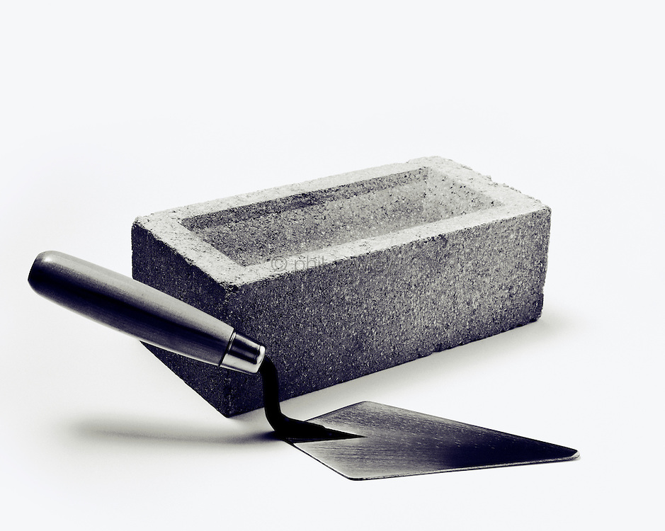 Trowel with a brick, bricklayers tools.