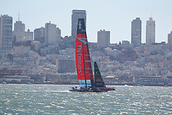 Emirates Team New Zealand skippered by Dean Barker sails in the San Francisco Bay during the 2013 America's Cup Finals San Francisco, California.