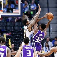 06 March 2017: Sacramento Kings guard Tyreke Evans (32) goes for the layup over Denver Nuggets forward Wilson Chandler (21) during the Denver Nuggets 108-96 victory over the Sacramento Kings, at the Pepsi Center, Denver, Colorado, USA.