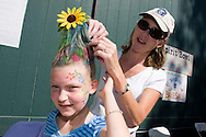 Michelle Oberst decorates her daughter Rachel's hair during the Spirit Bowl Flag Football tournament hosted by Horizon Prep Academy on October 24, 2008 in Rancho Santa Fe.  Michelle used an empty water bottle to support the unique hair style.