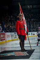 KELOWNA, CANADA - NOVEMBER 11: An RCMP officer stands at attention on the ice for Remembrance Day ceremonies at the Kelowna Rockets against the Red Deer Rebels on November 11, 2017 at Prospera Place in Kelowna, British Columbia, Canada.  (Photo by Marissa Baecker/Shoot the Breeze)  *** Local Caption ***