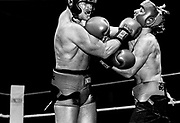 Robert Price takes a shot to the chin from Scott Wilson during their championship bout.