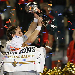 2010 February 07: New Orleans Saints quarterback Drew Brees (9) holds up the Vince Lombardi Trophy following a 31-17 win by the New Orleans Saints over the Indianapolis Colts in Super Bowl XLIV at Sun Life Stadium in Miami Gardens, Florida.