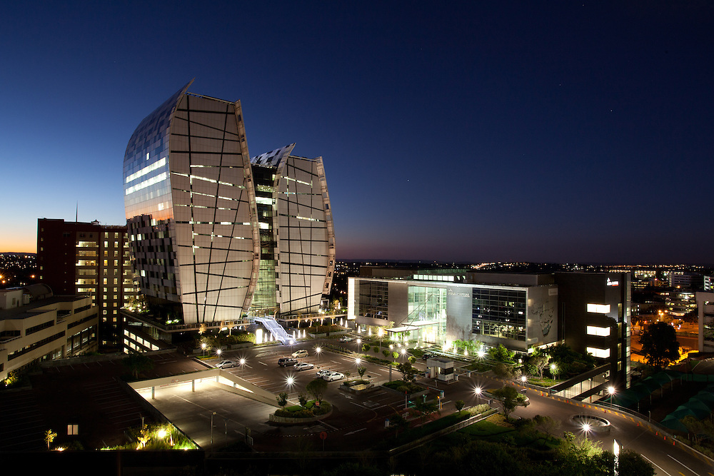 Alice Lane Towers, Norton Rose building at twilight in Sandton, Johannesburg, South Africa. Paragon Architects
