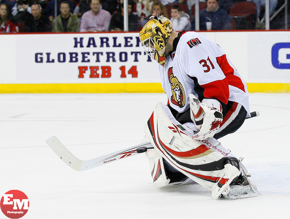 Jan 4, 2008; Newark, NJ, USA; Ottawa Senators goalie Alex Auld (31) makes a stick save during the second period at the Prudential Center.