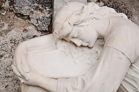 Ticino, Southern Switzerland. Sculpture of a sleeping angel on a tombstone.