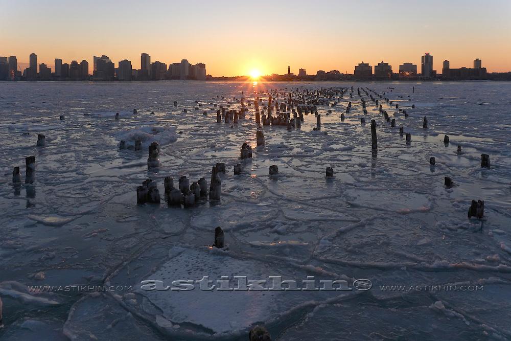 Ice on Hudson River at sunset.