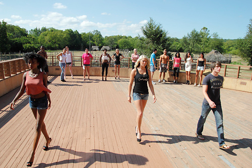 Serket Jewelry models (front row, from left) Aube Linda Jolicoeur of Lexington, Kentucky; Ceili Fitzpatrick of Middletown and Josh Grooms of West Union demonstrate their runway walk during a Dayton Fashion Week meeting at SunWatch Indian Village/Archaeological Park in Dayton, Saturday, July 21, 2012.