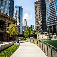 Chicago Riverwalk picture. Chicago Riverwalk is a popular downtown Chicago walking path along the Chicago River. Buildings include Trump Tower, Marina City Towers, United Airlines building, and Leo Burnett building. Photo is high resolution.