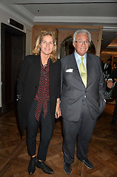 SIR DAVID & LADY TANG at a party hosted by Ewan Venters CEO of Fortnum & Mason to celebrate the launch of The Cook Book by Tom Parker Bowles held at Fortnum & Mason, 181 Piccadilly, London on 18th October 2016.