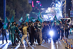 © Licensed to London News Pictures. 27/04/2014. Sulaimaniya, Iraq. Supporters of the Patriotic Union of Kurdistan (PUK) political party fly flags and let off fireworks during celebrations in the lead up to the 2014 Iraqi parliamentary elections in Sulaimaniya, Iraqi-Kurdistan.<br /> <br /> Although banned in other parts of Iraqi-Kurdistan, the days leading up to an election in Sulaimaniya sees political supporters of all the three main parties parading up and down the main street of the city, waving flags, honking horns, letting off fireworks and firing pistols and rifles into the air.<br /> <br /> The period leading up to the elections, the fourth held since the 2003 coalition forces invasion, has already seen six polling stations in central Iraq hit by suicide bombers causing at least 27 deaths. Photo credit: Matt Cetti-Roberts/LNP
