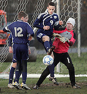 Susquehanna Valley's Justiin Caroway (9) kicks the ball away from the goal between teammates Ryan Bunker (12) and Colin Manchester, right, during a Class A state semifinal game against Ichabod Crane at Faller Field in Middletown on Saturday, Nov. 17, 2012.