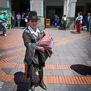 Saleslady in the main square in Quito Ecuador.