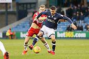 Middlesbrough midfielder Grant Leadbitter (7) and Millwall's Lee Gregory during the EFL Sky Bet Championship match between Millwall and Middlesbrough at The Den, London, England on 16 December 2017. Photo by Phil Duncan.