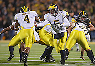 October 10, 2009: Michigan quarterback Tate Forcier (5) hands the ball off to Michigan running back Brandon Minor (4) during the first half of the Iowa Hawkeyes' 30-28 win over the Michigan Wolverine's at Kinnick Stadium in Iowa City, Iowa on October 10, 2009.