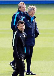 Sergio Aguero of Manchester City and manager Manuel Pellegrini smile during training  - Mandatory byline: Matt McNulty/JMP - 25/04/2016 - FOOTBALL - City Football Academy - Manchester, England - Manchester City v Real Madrid - UEFA Champions League Training Session