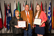 Vinita native Jessica Dobbs (right), an animal science major, receives an Oklahoma State University Win and Kay Ingersoll Scholarship from Win and Kay Ingersoll (left) at the university's recent College of Agricultural Sciences and Natural Resources Scholarships and Awards Banquet. The scholarship is part of more than $1.4 million in scholarships and awards presented to CASNR students for the 2016-2017 academic year. (Photo by Todd Johnson)