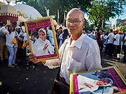 30 NOVEMBER 2017 - YANGON, MYANMAR: People selling portraits of Pope Francis in front of the cathedral during the Papal Mass at St. Mary's Cathedral in Yangon. Thursday's mass was his last public appearance in Myanmar. From Myanmar the Pope went on to neighboring Bangladesh.    PHOTO BY JACK KURTZ