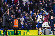 Neal Maupay (Brighton) breaks free from an embrace from Ezri Konsa (Aston Villa) as both players went to leave the pitch following the final whistle after the Premier League match between Brighton and Hove Albion and Aston Villa at the American Express Community Stadium, Brighton and Hove, England on 18 January 2020.