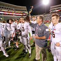 Thomas Wells | Buy at PHOTOS.DJOURNAL.COM<br /> East Webster head coach Doug Wilson holds up the second place trophy following their 39-20 defeat to Basfield in the 2A State Championship game on Friday in Oxford.