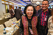 15 DECEMBER 2013 - BANGKOK, THAILAND:  Dr. Thida Thavornseth (left) and Jutaporn Prompan, both core leaders of the United Front for Democracy Against Dictatorship (UDD also known as Red Shirts) leave a forum on political reform in Thailand at the Queen Sirikit National Convention Center. The forum was organized by Thai Prime Minister Yingluck Shinawatra.      PHOTO BY JACK KURTZ