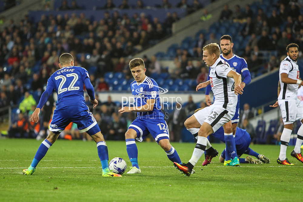 Matej Vydra of Derby County puts pressure on Stuart O'Keefe of Cardiff City and Declan John of Cardiff City during the EFL Sky Bet Championship match between Cardiff City and Derby County at the Cardiff City Stadium, Cardiff, Wales on 27 September 2016. Photo by Andrew Lewis.