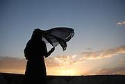 """""""New Day'"""" by Amira Al-Sharif Yemeni Woman looks at sunset."""