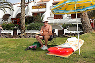 A pensioner has made himself comfortable on the beach. Everything is well organized.