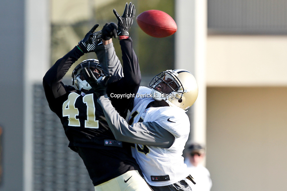 July 29, 2012; Metairie, LA, USA; New Orleans Saints safety Roman Harper (41) breaks up a pass intended for wide receiver Courtney Roby (15) during a training camp practice at the team's practice facility. Mandatory Credit: Derick E. Hingle-US PRESSWIRE
