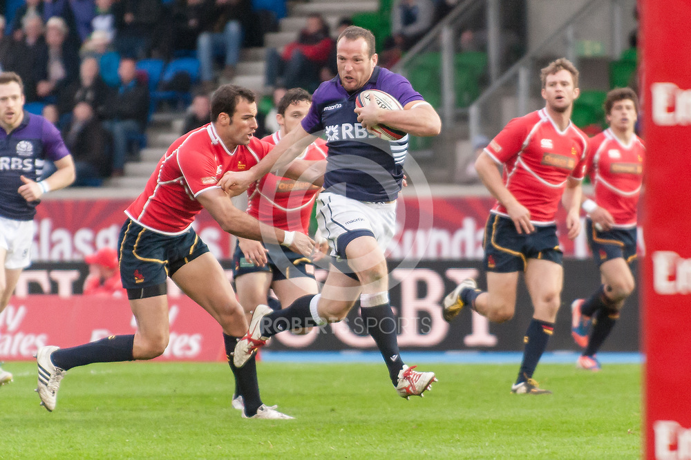 Scotland's James Eddie bursts through the Spanish defence to score a try. Action from the IRB Emirates Airline Glasgow 7s at Scotstoun in Glasgow. 3 May 2014. (c) Paul J Roberts / Sportpix.org.uk