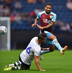 Burnley's Aaron Lennon is tackled by Preston North End's Andrew Hughes during a pre season friendly match at Deepdale, Preston.