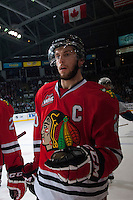 KELOWNA, CANADA - APRIL 25: Taylor Leier #20 of the Portland Winterhawks skates to the bench to celebrate a goal against the Kelowna Rockets on April 25, 2014 during Game 5 of the third round of WHL Playoffs at Prospera Place in Kelowna, British Columbia, Canada. The Portland Winterhawks won 7 - 3 and took the Western Conference Championship for the fourth year in a row earning them a place in the WHL final.  (Photo by Marissa Baecker/Getty Images)  *** Local Caption *** Taylor Leier;