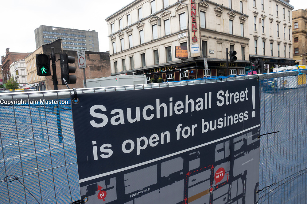 Sign on Sauchiehall Street stating shops are open for business following major fire in nightclub, Glasgow , Scotland, UK